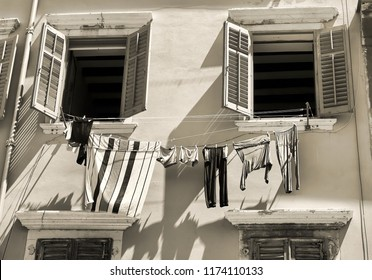 historical building with clothesline in the old town of Rovinj in Croatia