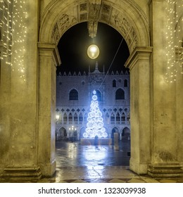 Historical buildings at misty winter night at Piazza San Marco in Venice, Italy.