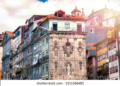 Historical buildings of the old center of Porto at Praça da Ribeira with sunspot