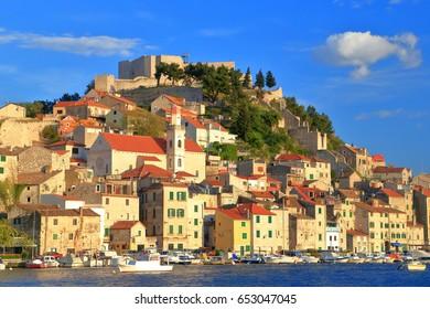 Historical buildings on a hillside by the sea near the harbor of Sibenik, Croatia