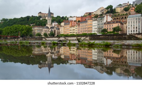 The historical buildings of UNESCO world heritage site Vieux-Lyon reflected in a puddle. Lyon, France.