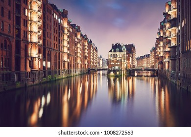 Historical buildings of the warehouse district at sunset. Speicherstadt is tourist popular place in Hamburg (Germany) on the UNESCO World Heritage Site.