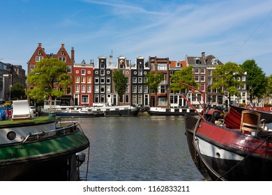 Historical canalhouses on the Amstel canal in the old center of Amsterdam, the Netherlands.