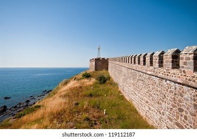 Historical Castle At Babakale, Canakkale, Turkey. Looking Over The Aegean Sea From The Castle With Graves In Front.
