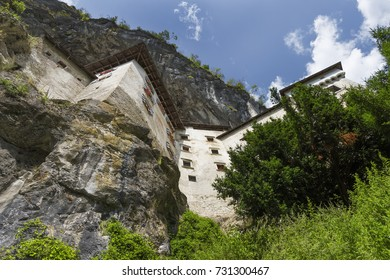 Historical castle built within a cave mouth.