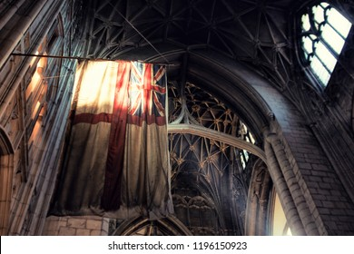 Historical cathedral in Great Britain with old flag and ancient ceiling.