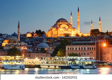 The historical center of Istanbul in the evening, Turkey. Illuminated Istanbul at night. View of Istanbul with a large mosque.