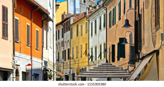 The historical center of old town Grosseto Maremma with old colorful buildings and facades with windows, Tuscany Italy