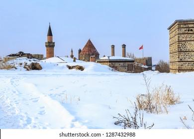 Historical cifte minareli (double minaret) madrasah, erzurum castle area with snow in Erzurum, Turkey