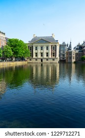 historical city center of Den Haag - Dutch pairlament Binnenhof, Mauritshuis and with reflections in pond, Netherlands