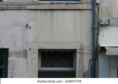 of a historical city in france details and colors of buildings show distressed used look