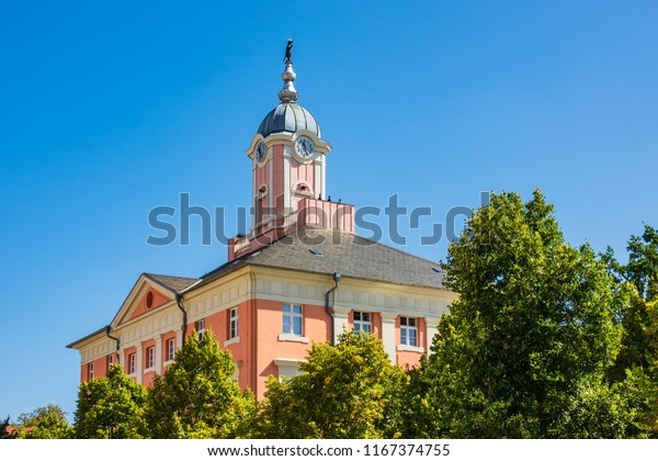 Historical city hall with trees in Templin, Germany.