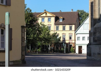 historical city schwaebisch gmuend catholic church details ornaments and roof in south germany sunny summer day
