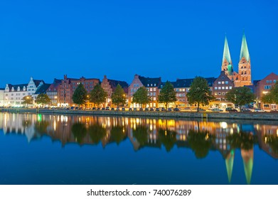 Historical cityscape at the river Untertrave with church of Saint Mary in Lubeck at the Baltic Sea