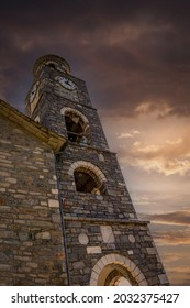 Historical clock tower in Greece, dramatic photo of old clock tower in Pelion, Greece
