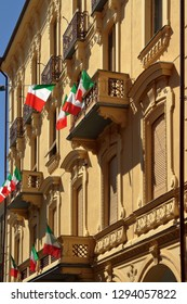 historical colored buildings with italian flags in asti city in italy in europe