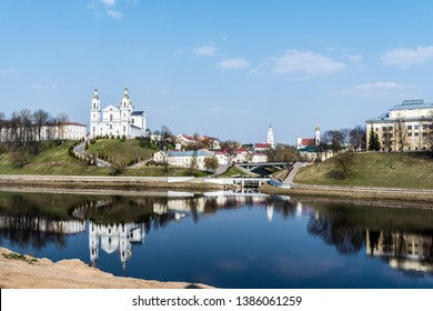 Historical cultural part of the city with bridges over the river, town hall and domes of cathedrals, Uspensky Cathedral Vitebsk, Belarus. Spring time