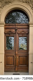 Historical Decorative Wooden Door with Glass Panes and Arcs in Stone Entry, Prague