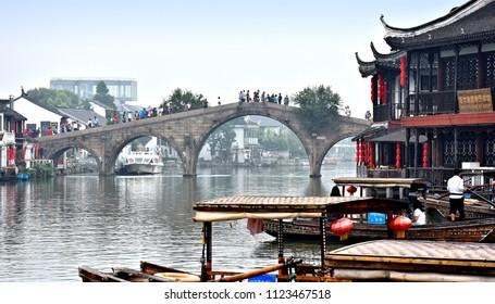 Historical Fangsheng bridge in Zhujiajiao (water town near Shanghai - also called Venice of China). The bridge is major tourist attraction in the town. Photo taken 2018-05-29.