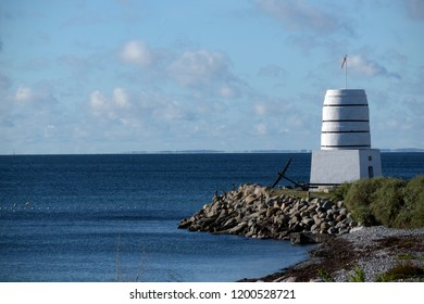 historical flintstone oven from Roedvig, landmark and viewpoint at the Baltic Sea coast of Denmark, blue sky, copy space