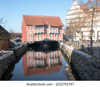 Historical half-timbered house, called Brueckenhaus (bridge house), spans the canal to the harbor of Wismar in Mecklenburg-Vorpommern, Northern Germany