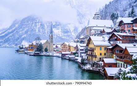 Historical Hallstatt town on a lake in Alps mountains, Austria, snow covered in winter time, is on UNESCO World Culture Heritage list