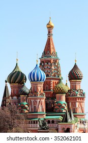 A historical landmark - St. Basil's Cathedral in Moscow's red square, interesting architectural ensemble. Near the monument to the founders of Slavic writing Cyril and Methodius