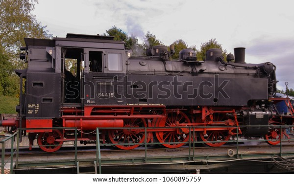 A historical large locomotive on a rail yard, The Netherlands