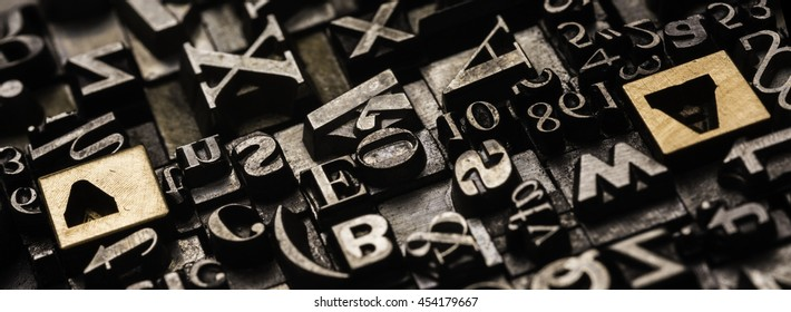 Historical letterpress types, also called as lead letters. These kind of letters were used in Gutenberg presses. These letters were the beginning of typography. And were used in typesetting