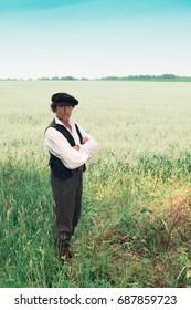 Historical man standing in rural field