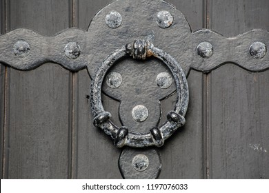 Historical old antique door handle close-up of a castle wooden door background texture iron