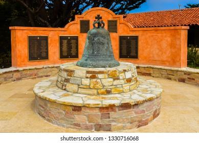 Historical old bell on display at Mission Carmel church courtyard - Carmel, California.