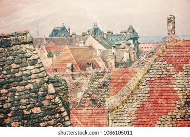 Historical old buildings roofs in Sibiu Romania as vintage postcard