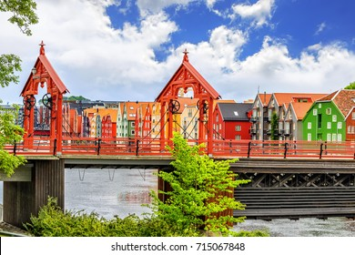 Historical Old Timber Buildings, Old Town Bridge (Norwegian: Gamle Bybro or Bybroa) over the river Nidelva in Trondheim. Trondheim, historically Kaupangen, Nidaros and Trondhjem, Norway.