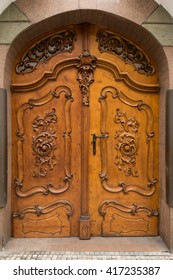 Historical Ornate Wooden Door with Arc and Glass Pane, Prague, The Czech Republic