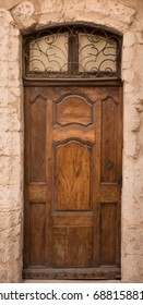 Historical Ornate Wooden Door with Arcs and Glass Panes, Marseille, France