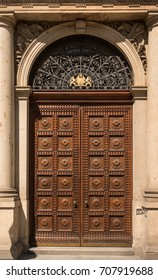 Historical Ornate Wooden Door in a Decorated Stone Entry with Columns and Arcs, Prague, The Czech Republic, Europe