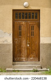 Historical Ornate Wooden Door with Glass Panes in a Stone Entry, Prague, The Czech Republic