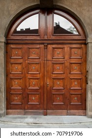 Historical Ornate Wooden Door with Glass Panes in a Stone Entry with Columns and Arcs, Prague, The Czech Republic, Europe