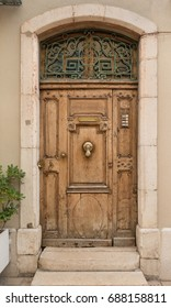 Historical Ornate Wooden Door with Knocker and Glass Panes, Marseille, France