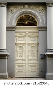 Historical Ornate Wooden Door in a Stone Entry with Arc and Pillars, Prague, The Czech Republic