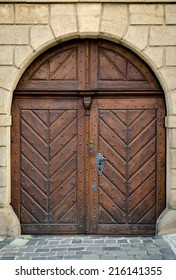 Historical Ornate Wooden Door in a Stone Entry with Arc, Prague, The Czech Republic