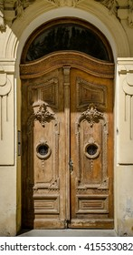 Historical Ornate Wooden Door in a Stone Entry with Arc and Glass Pane, Prague, The Czech Republic