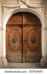 Historical Ornate Wooden Door in a Stone Entry with Columns and Arcs, Prague, The Czech Republic, Europe