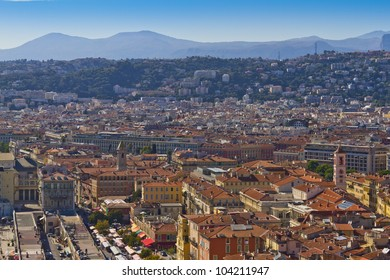 Historical part of Nice - luxury resort of Cote d'Azur, France. Wonderful panoramic view of Nice with colorful historical houses of the old city.
