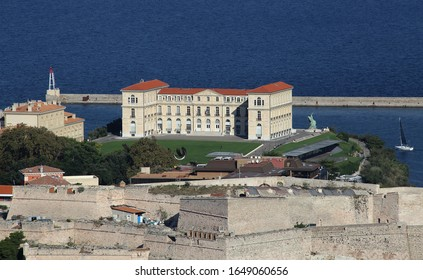 Historical pharo building and ancient fortifications in the old harbor of Marseille, France