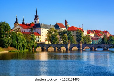 Historical Pisek Old Town, Czech Republic, with stone Old Bridge, Pisek Castle and St Mary Church - Shutterstock ID 1185181495