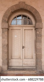 Historical Plank Wooden Door with Glass Panes in Stone Arc, Marseille, France