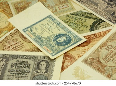 """Historical Polish notes (1920 -1940). Text on the notes is the warning from the Polish bank- translation: """"Polish Bank, 5 zloty's"""". Focus on some  part of the image only - rest is blur by intention."""