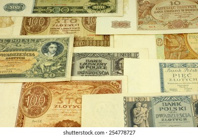 "Historical Polish notes (1920 -1940). Text on the notes is the warning from the Polish bank- translation: ""Polish Bank, 5 zloty's"". Focus on some  part of the image only - rest is blur by intention."